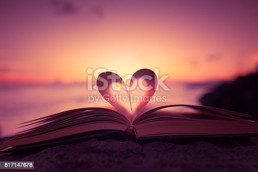 istock Heart shape paper book on the beach 817147678