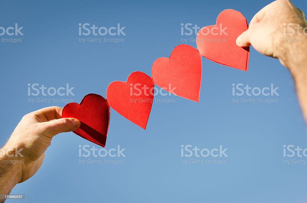 Heart shape paper dolls in the Air royalty-free stock photo