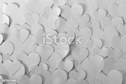 Romantic background. Lots of heart shape papers