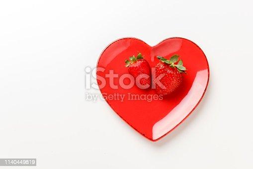 istock Heart shape plate with fresh strawberries 1140449819