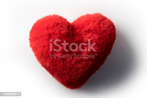 Fluffy heart shaped soft red cushion or pillow for Valentine's day visualising love