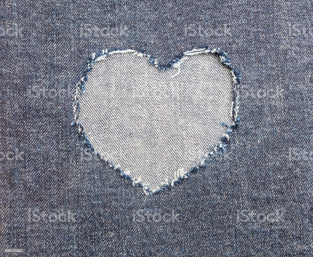 Heart shape ripped jean for Valentine's card background royalty-free stock photo