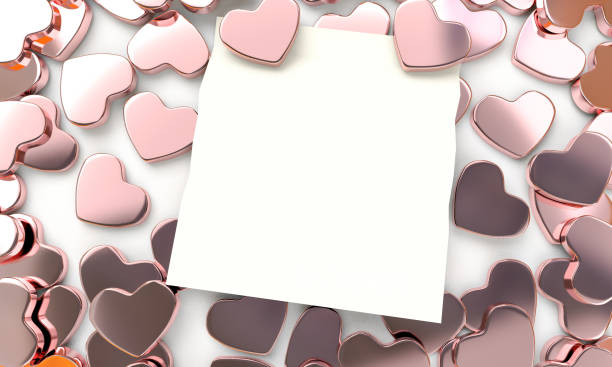 3D heart shape rose gold color wallpape with note paper stock photo
