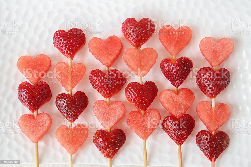 heart shape strawberry and watermelon fruit  skewers stock photo