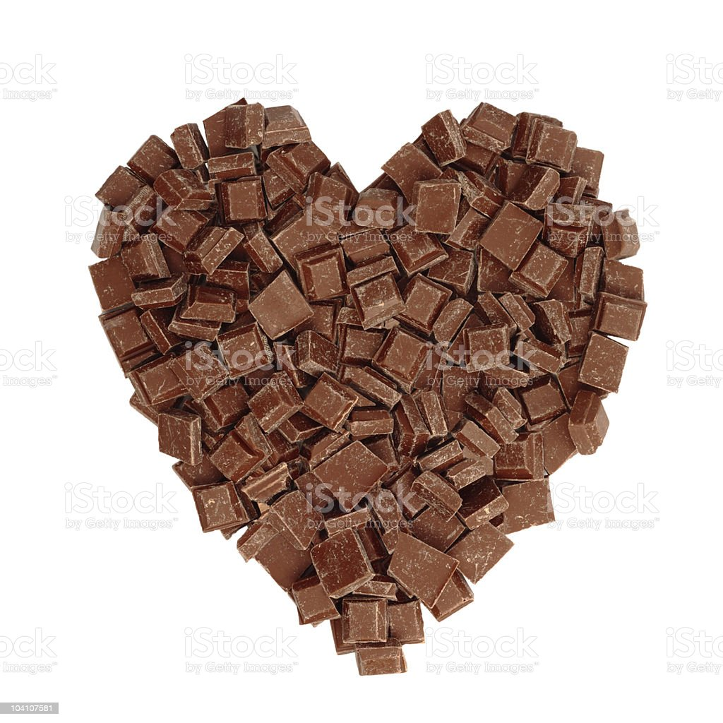 Heart shape symbol made of chocolate pieces royalty-free stock photo