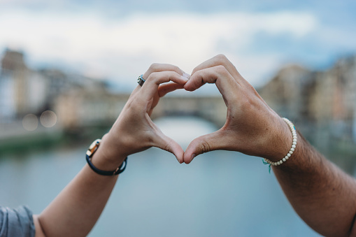 Heart shape symbol with hands in Florence, Italy
