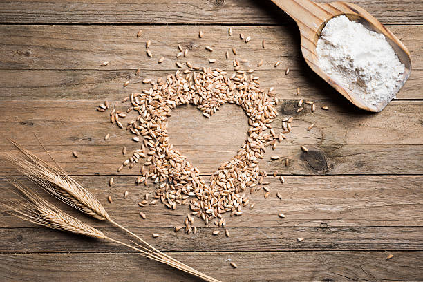 Heart shape wheat Heart shape wheat on wood table spelt stock pictures, royalty-free photos & images