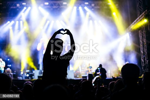 1069137774 istock photo Heart shape with hands at the concert 504563193