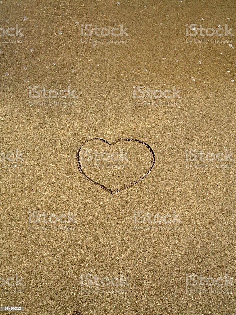Heart shape written in Espana beach sand royalty-free stock photo