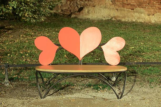 Heart shaped bench stock photo
