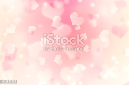 istock Heart shaped bokeh pink blurred background. 812987258