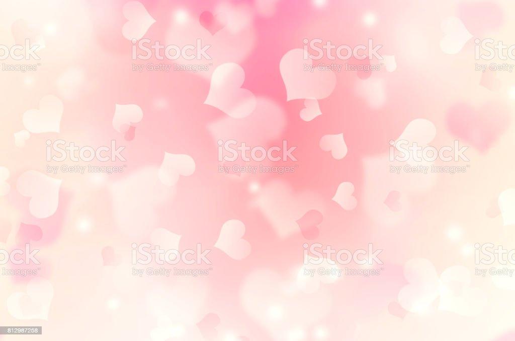 Heart shaped bokeh pink blurred background. stock photo