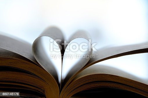 503130452istockphoto Heart Shaped Book 650145176