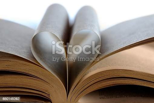 503130452istockphoto Heart Shaped Book 650145262