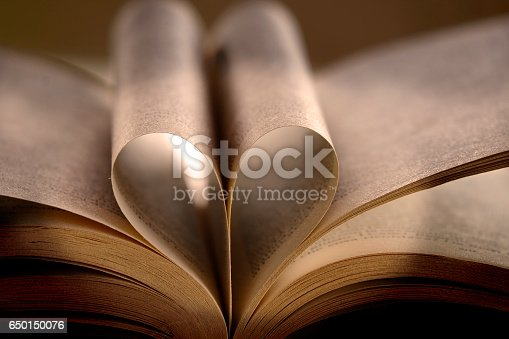 503130452istockphoto Heart Shaped Book 650150076