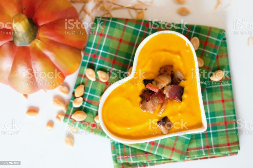 Heart shaped bowl of cream pumpkin soup stock photo