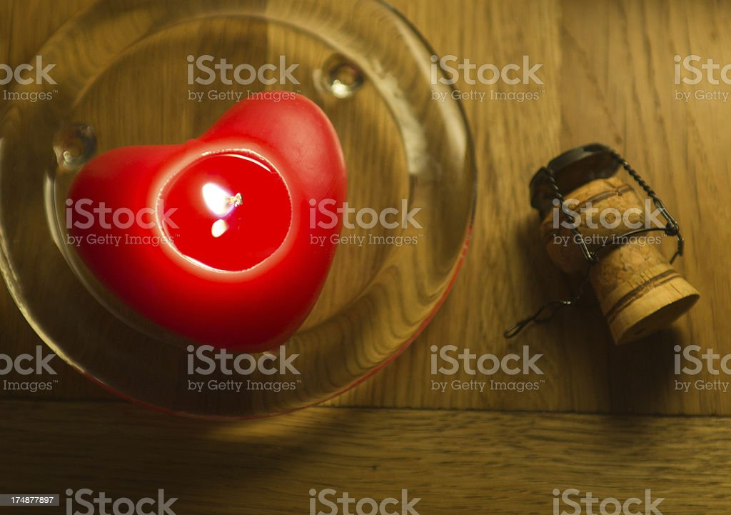 Heart shaped candle on glass plate royalty-free stock photo