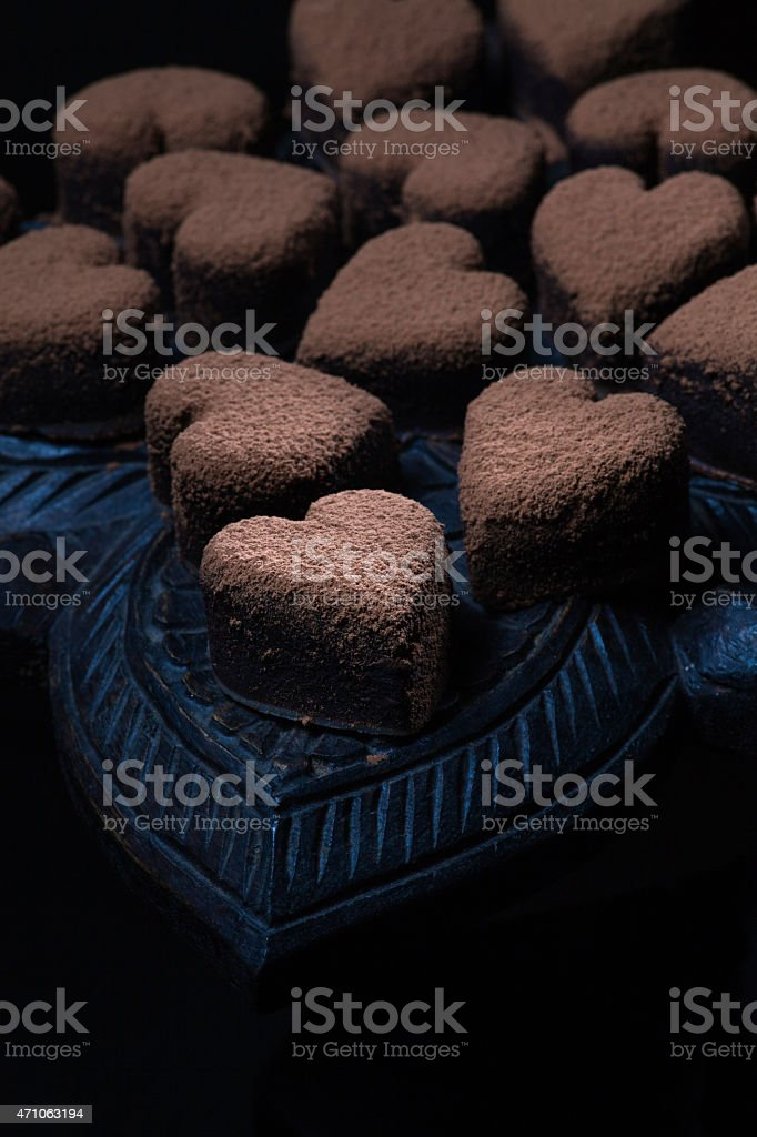 Heart shaped chocolate truffle. Gift for Valentine Day stock photo