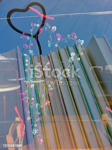1057183432 istock photo Heart shaped christmas decoration on a stack of books 1070491958