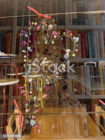 1057183432 istock photo Heart shaped christmas decoration on book shelves background 1070491826