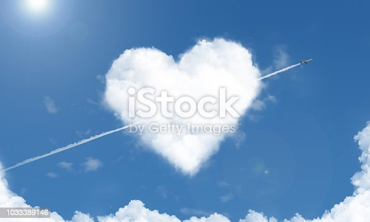 istock heart shaped cloud and airplane in the sky 1033389146
