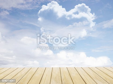 istock heart shaped cloud in blue sky 526274041