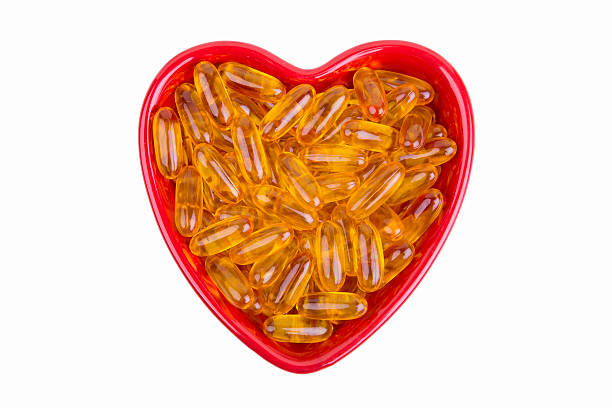Heart Shaped dish with fish oil stock photo