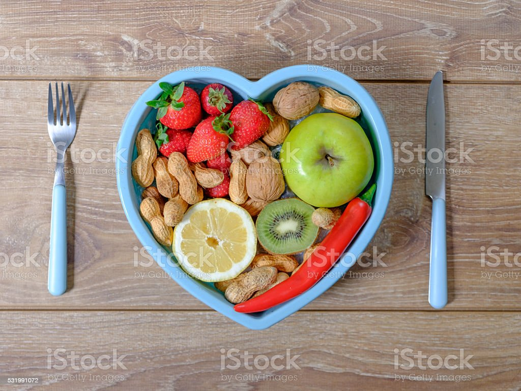 Heart shaped dish with vegetables isolated stock photo