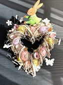 Heart shaped easter wreath on black background