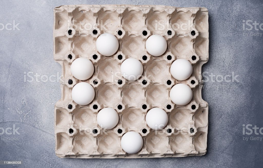 Eggs laid out in the shape of a heart in a box of eggs. The concept...