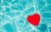 Heart shape in swimming pool - holiday concept