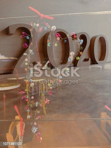 istock Heart shaped floral christmas wreath with year 2020 1071391122