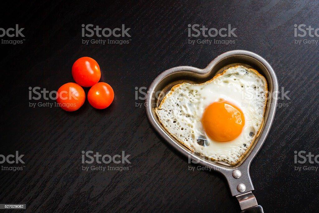 heart shaped fried egg stock photo