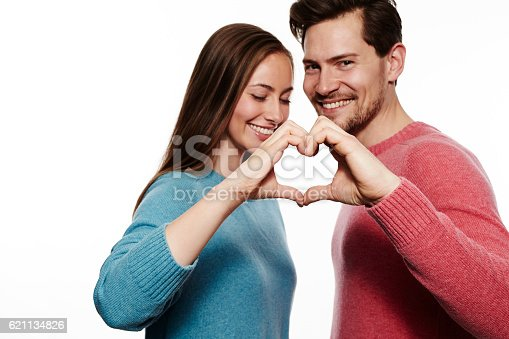 621502402 istock photo Heart shaped gesture made by couple 621134826