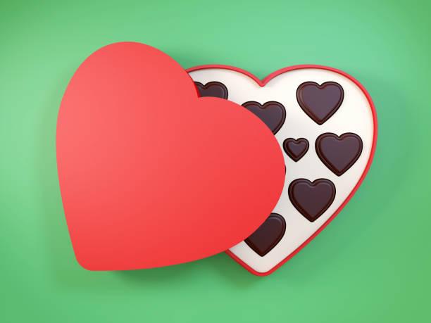 herzförmige geschenkbox mit schokolade. 3d-rendering. - schokoladen trüffeltorte stock-fotos und bilder