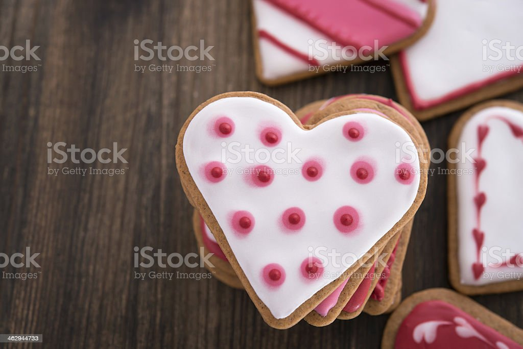Heart shaped ginger cookies on wooden background royalty-free stock photo