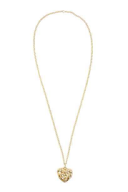 heart shaped gold necklace on white background - ожерелье стоковые фото и изображения