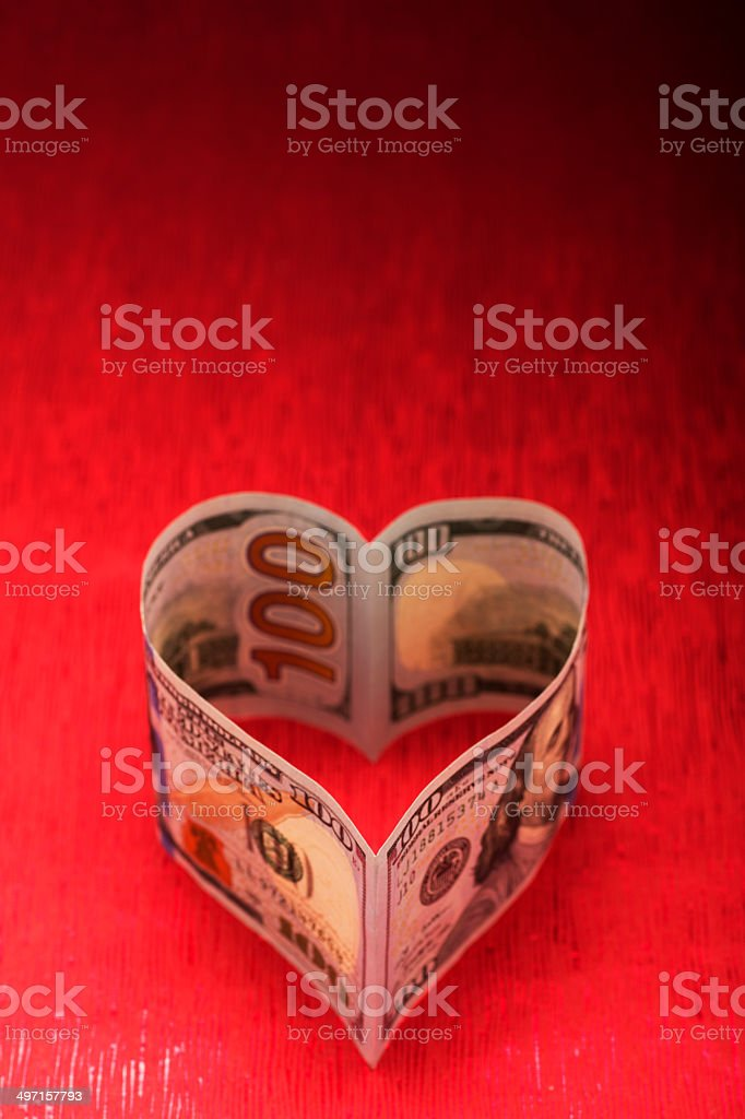 Heart Shaped Hundred Dollar Bills on Red stock photo