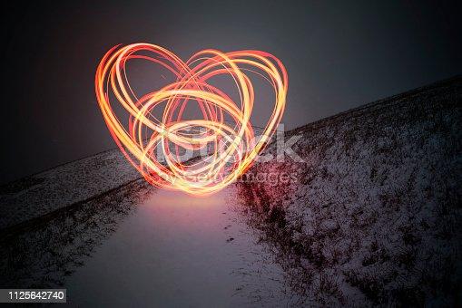 istock Heart shaped light painting 1125642740