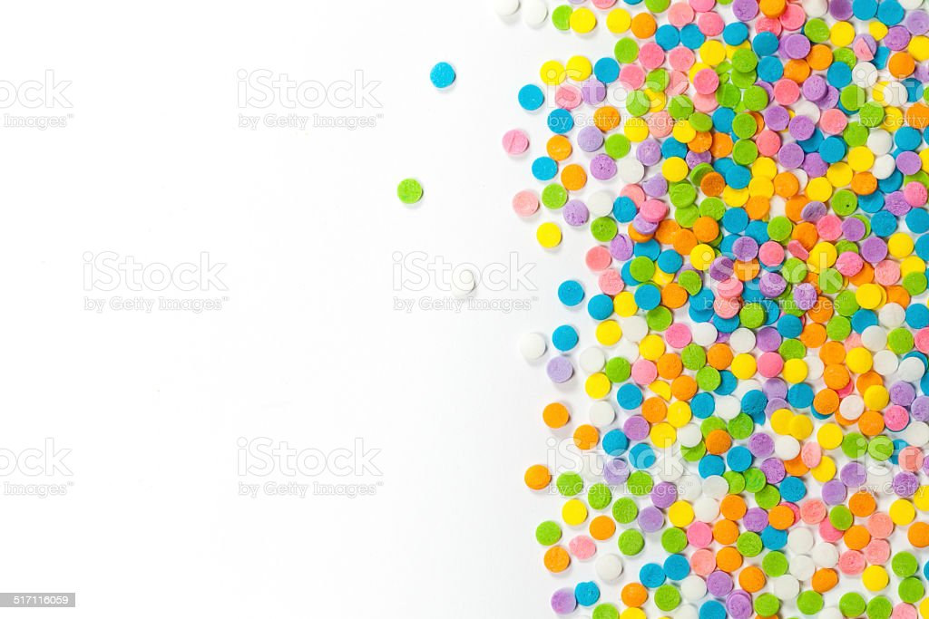 Heart shaped made from colored sprinkles stock photo