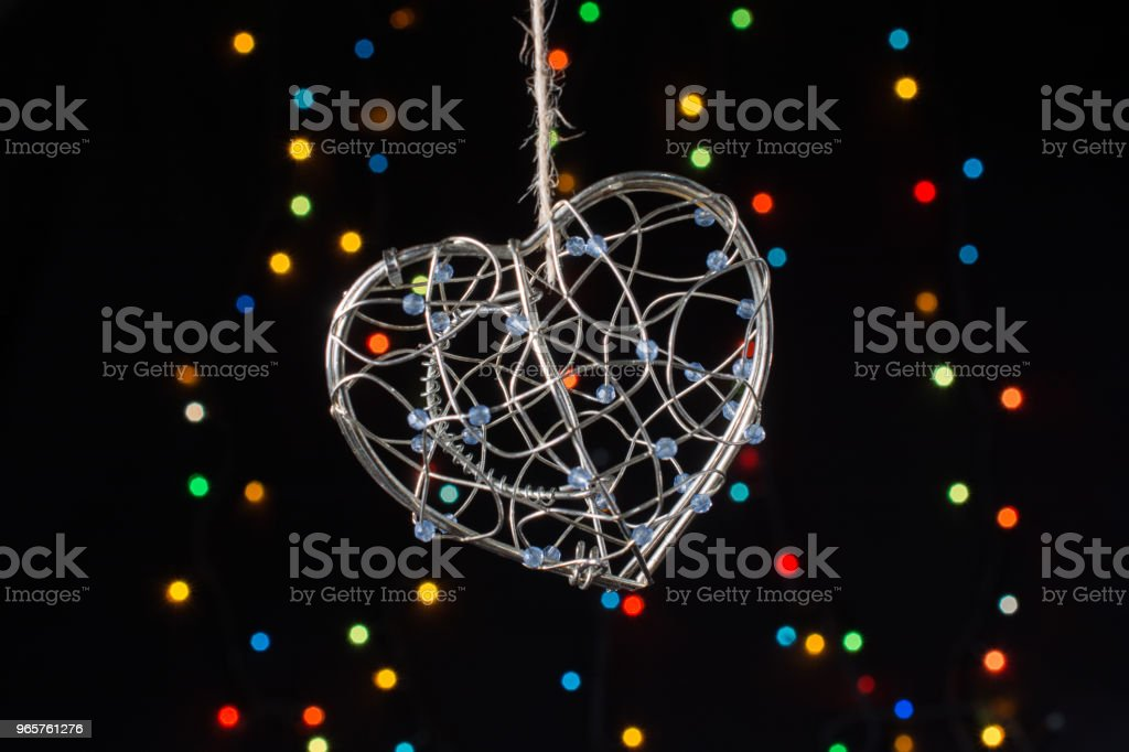 Heart shaped metal cage on bokeh light background - Royalty-free Boyfriend Stock Photo