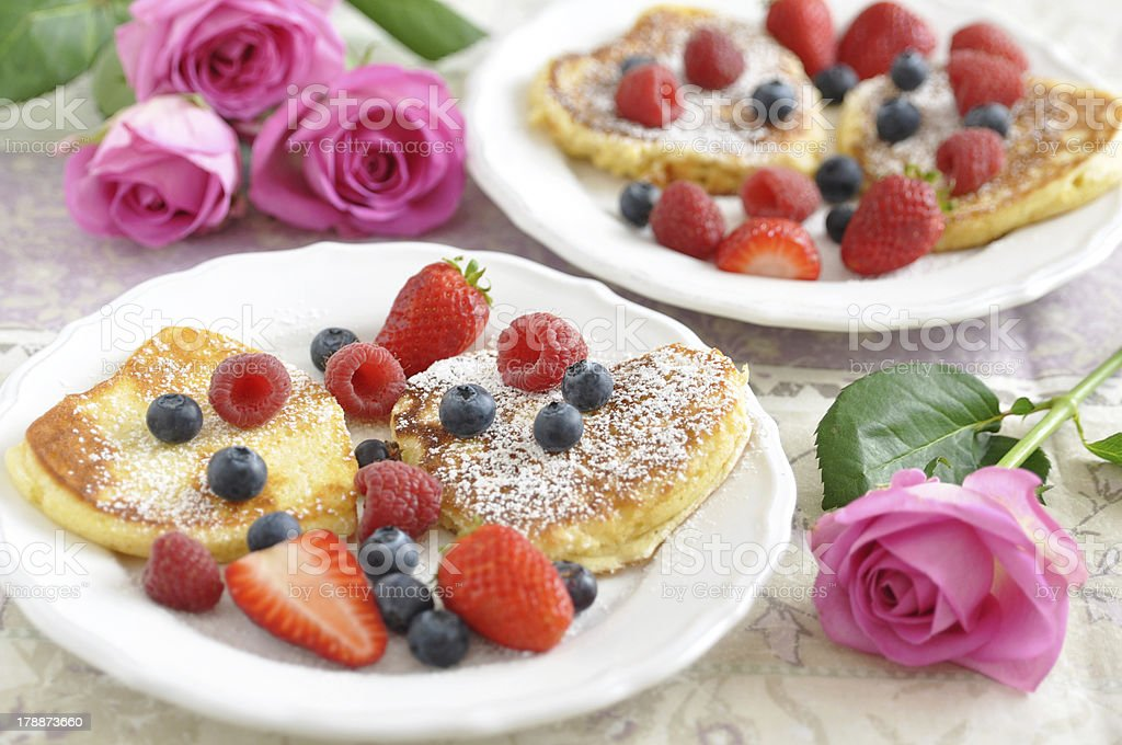 Heart shaped pancakes with fresh berries stock photo