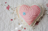 heart shaped pillow with pearls