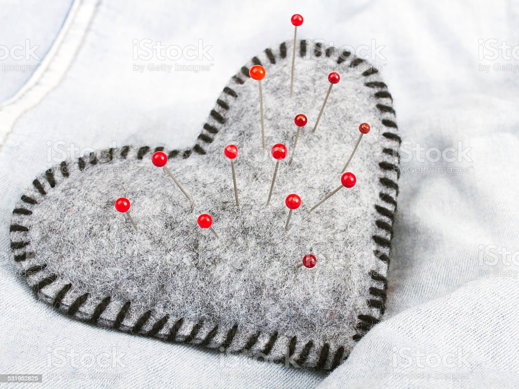 Heart shaped pincushion stock photo