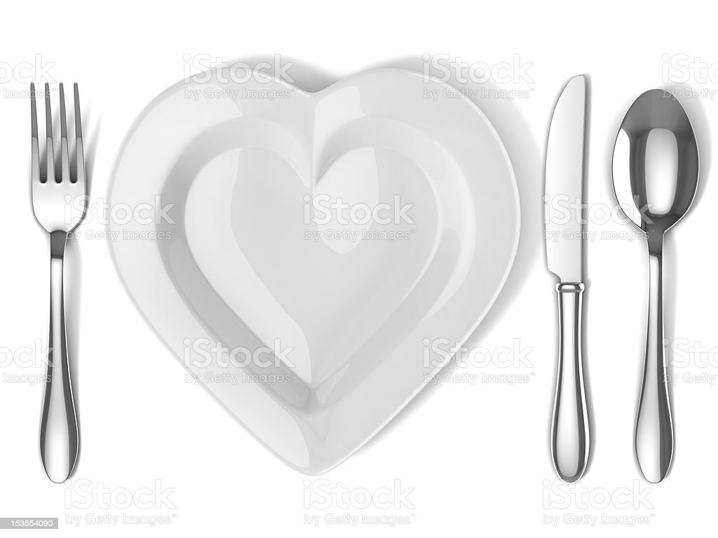 heart shaped plate with silverware royalty-free stock photo