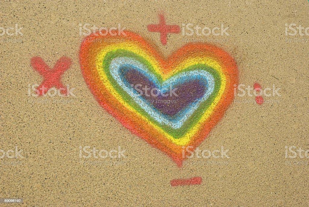 Heart shaped rainbow graffiti on a wall royalty-free stock photo