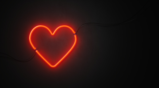 Heart Shaped Red Neon Light On Black Wall - Valentines Day Concept