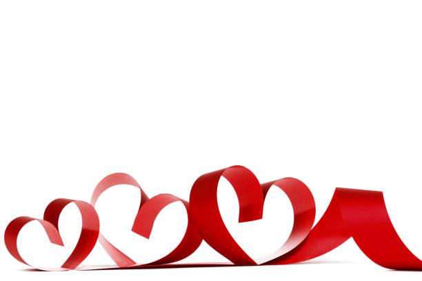 Heart shaped red ribbon stock photo