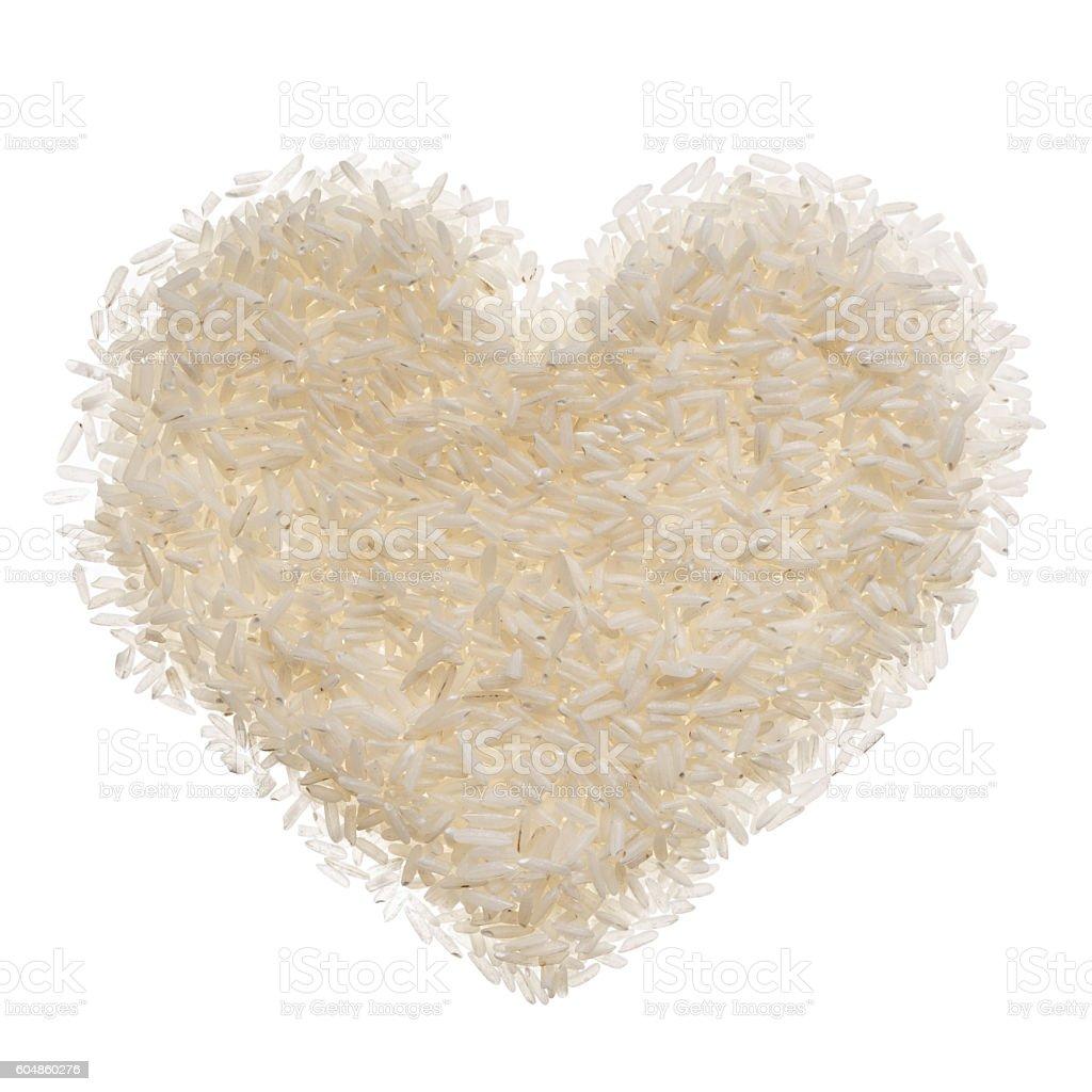Heart shaped Rice heap against white stock photo