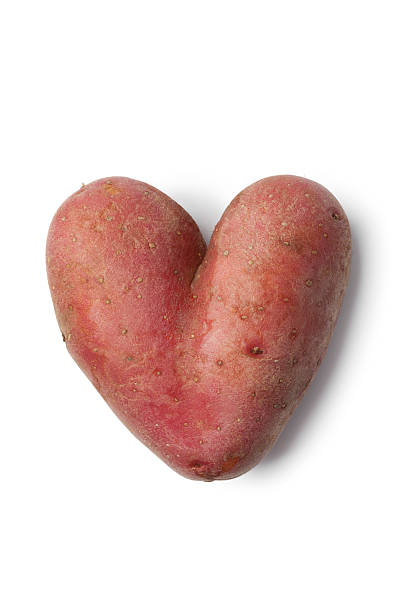 heart shaped roseval potato - disfigure stock pictures, royalty-free photos & images